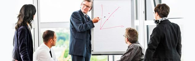 Businessman drawing a graph in a meeting room